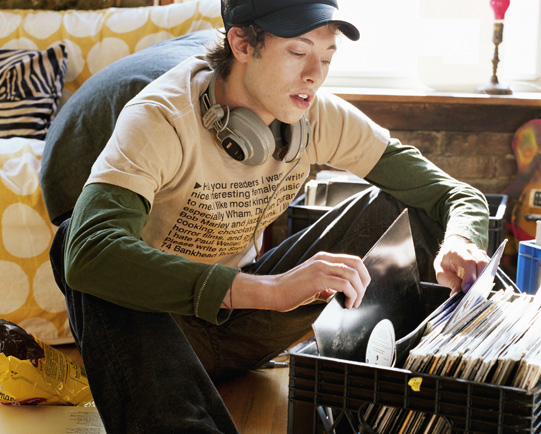 young-man-looking-through-vinyl-records