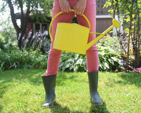 young-woman-holding-watering-can