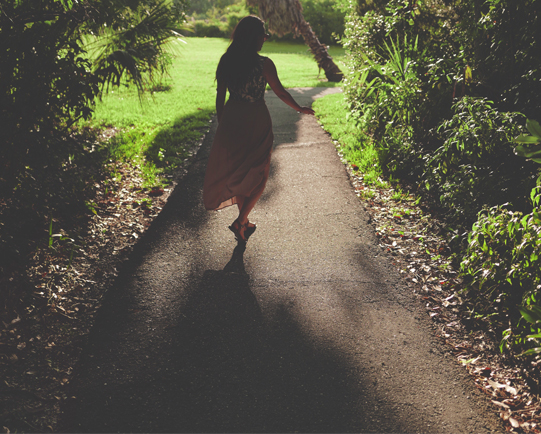 Woman-walking-down-pathway