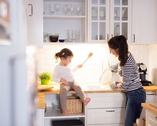 Mother and daughter in white kitchen